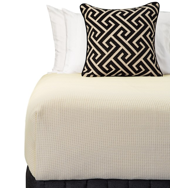 Bed Dressed with Carlo Blanket (Stone), Suite Valance (Siam Black), Large Decorative Cushion (Apollo Jet), Microball Resort Pillows with Corniche White Standard Pillowcases